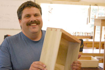 Happy woodworker with dovetail drawer - we have strong commitment to woodworkers