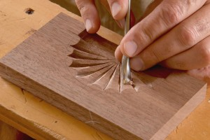 Keep the gouge very sharp, take light cuts, and watch the changes in the grain